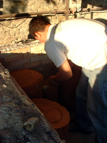 The molds are set on blocks and slightly away from each other to leave a convection-space within the kiln.