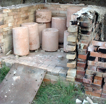 View of the kiln as it is being unloaded the next morning.